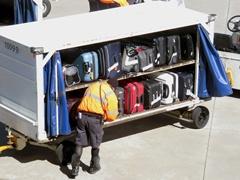 An Airport Baggage Handler Checks Luggage